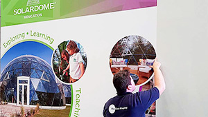 Bluedot Display installing vinyl wall graphics for Soladome