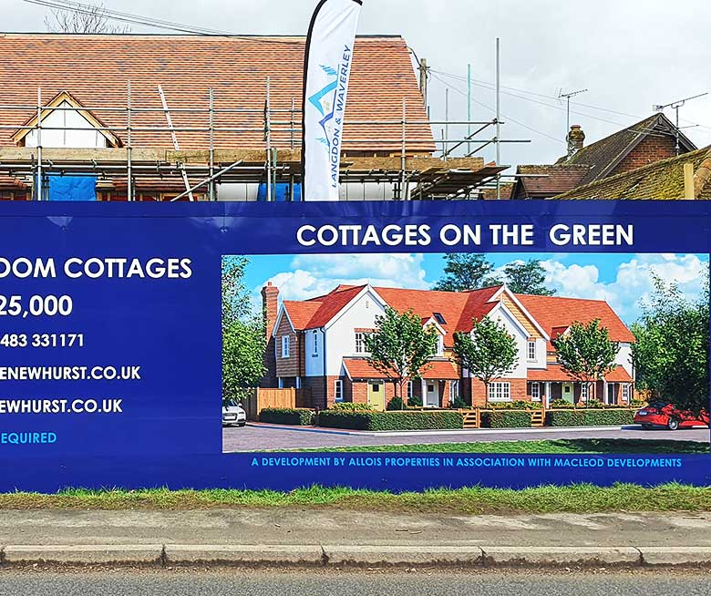 Bibond construction site hoardings at a luxury development of homes in Shamley Green Surrey